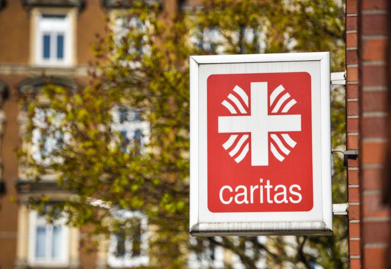 Schild Caritas